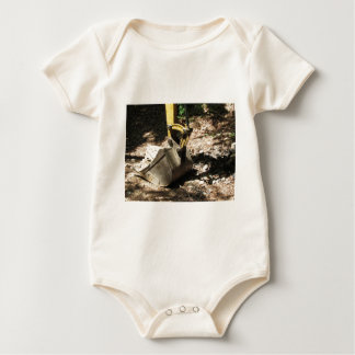 The bucket of the excavator sits at rest baby bodysuit