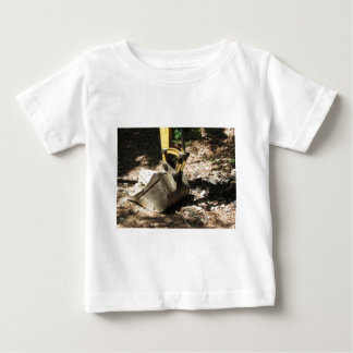 The bucket of the excavator sits at rest baby T-Shirt