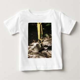 The bucket of the yellow excavator sits at rest baby T-Shirt