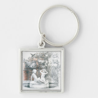 the city fountain with figurines of girls keychain