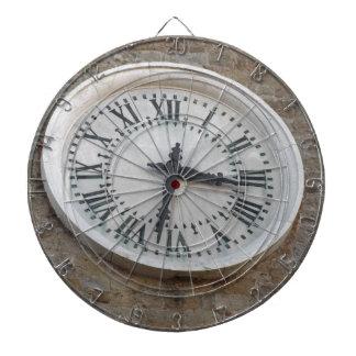 The clock on the facade of the Palazzo dei Priori Dartboard