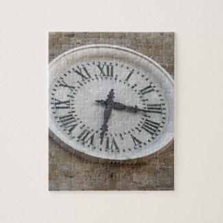 The clock on the facade of the Palazzo dei Priori Jigsaw Puzzle