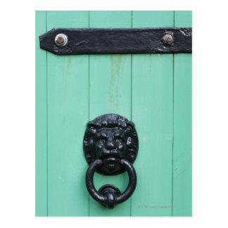 The door knocker of the Gardner Postcard