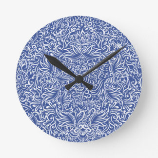The flowing vines of  night blue round clock