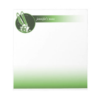 the funny rabbit looks into round window cartoon notepads