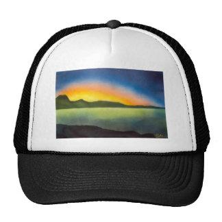 The glow of a setting sun trucker hat