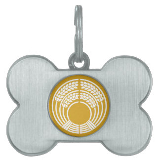 The god of harvest holding rice plant pet tag
