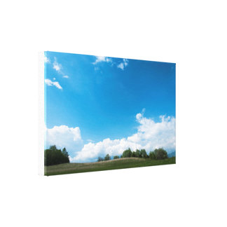 The green hill and the blue sky canvas print