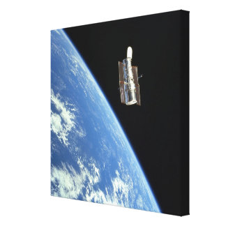 The Hubble Space Telescope with a blue earth Canvas Print