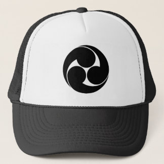 The left three-sided crest (area pulling out trucker hat