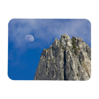 The moon rises and shines through the clouds rectangular photo magnet