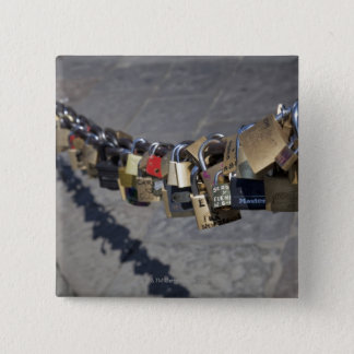 the new tradition of 'locks of love' attached by 2 inch square button