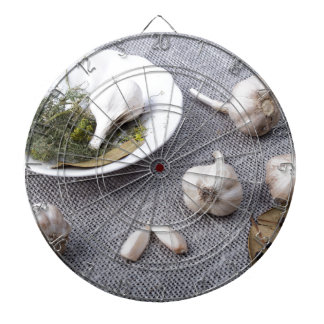 The old saucer, garlic and spices dartboard with darts