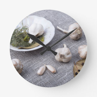 The old saucer, garlic and spices round clock