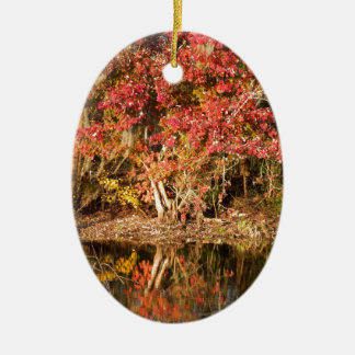 The Red Tree at Sunset Ceramic Oval Ornament