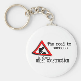 The road to success is always under construction keychains