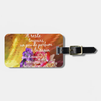 The scent of the roses still remains in the hand. luggage tag