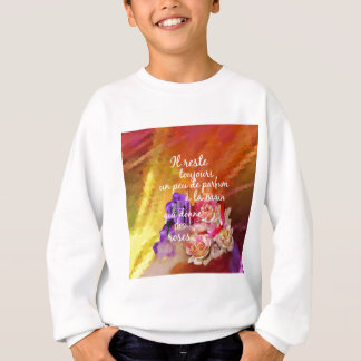 The scent of the roses still remains in the hand. sweatshirt