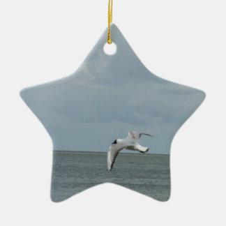 The sea gull and the sea ceramic ornament