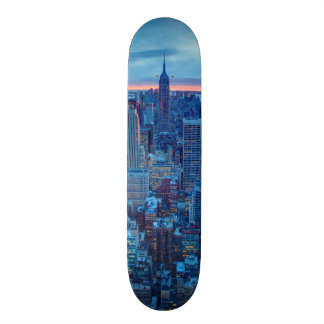 The skyscrapers of Manhattan are lit Skateboard