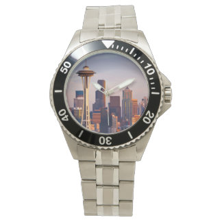 The Space Needle is a tower at dusk in Seattle Wristwatches