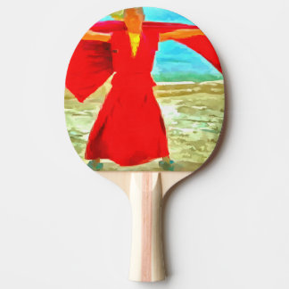 The super fit monk in red ping pong paddle