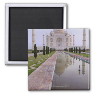 The Taj Mahal perfectly reflected in the still Magnet