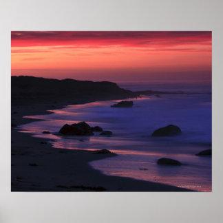 The warm hues of dawn reflect along the print