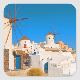 The white buildings and the windmills on the square sticker