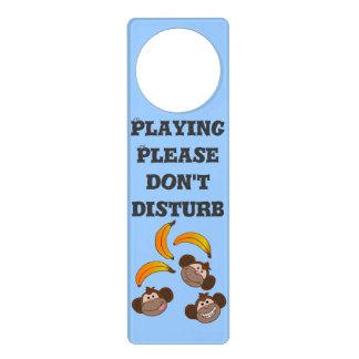Thee monkeys and bananas door hanger
