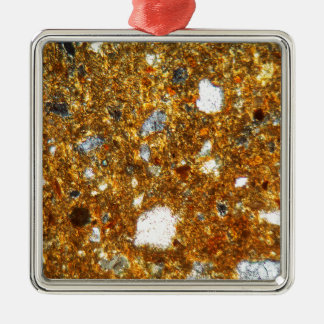 Thin section of a brick under the microscope metal ornament