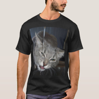 Thirsty Cat Drinking From Kitchen Tap. T-Shirt