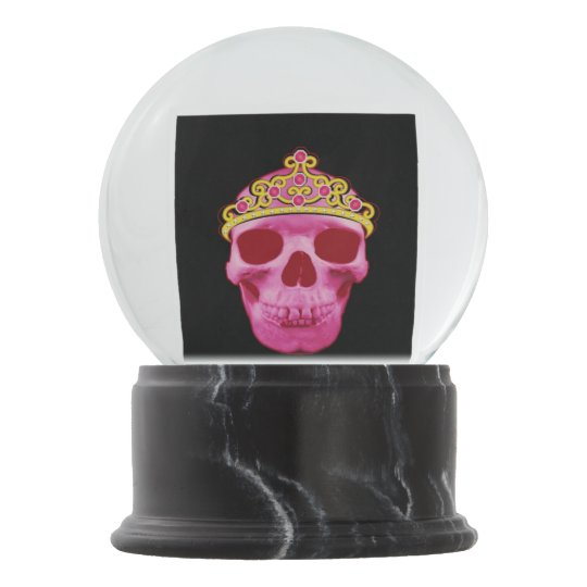 This pink princess skull wearing a tiara is sure t snow globe