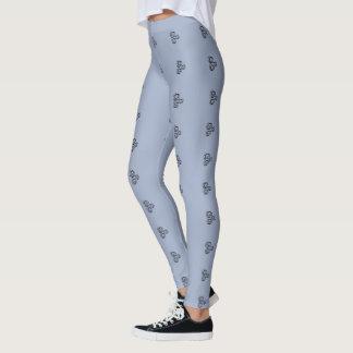 Three black swirls graphic on blue/grey legging