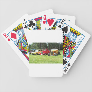 Three classic cars on the grass bicycle playing cards