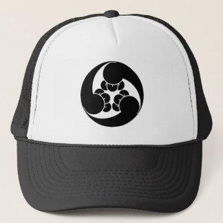 Three counterclockwise clove swirls trucker hat