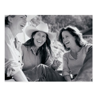 Three cowgirls laughing together postcard