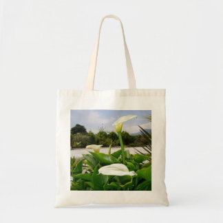 Three Cream Calla Lilies With Garden Background Tote Bag