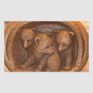 Three cute wooden carved bears on plaque