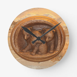 Three cute wooden carved bears on plaque clock