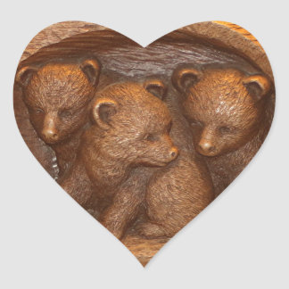 Three cute wooden carved bears on plaque heart sticker