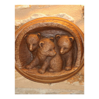 Three cute wooden carved bears on plaque letterhead