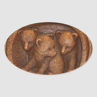 Three cute wooden carved bears on plaque oval sticker