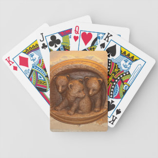 Three cute wooden carved bears on plaque poker deck