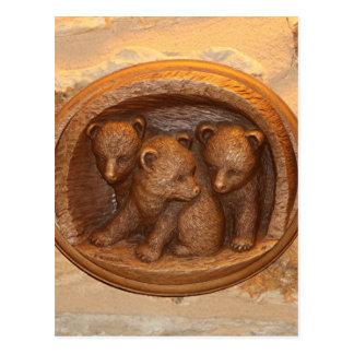 Three cute wooden carved bears on plaque postcard