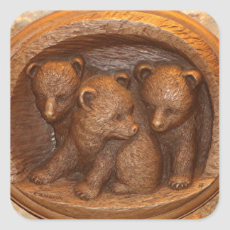 Three cute wooden carved bears on plaque square sticker