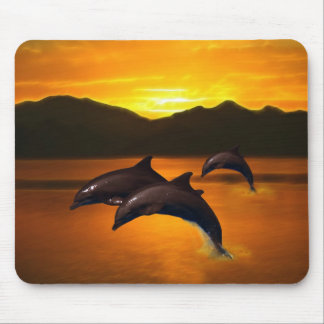Three dolphins at sunset mouse pad