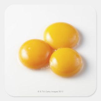 Three egg yolk square sticker