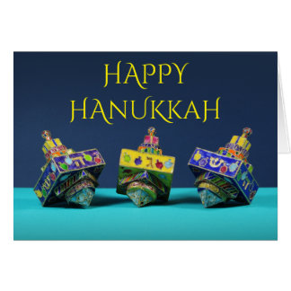 Three enameled dreidels Hanukkah card