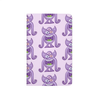 Three-eyed alien monster laughing mischievously journal